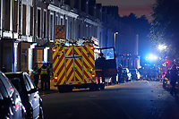 Pictured: Fire crews at the scene of a fire in Swansea, Wales, UK. Wednesday 24 October 2018<br /> Re: Firefighters are battling a fire in Swansea, Wales, UK.<br /> The fire is in a back lane running parallel between Carlton Terrace and Mansel Street in the Mount Pleasant area.<br /> South Wales Fire and Rescue Service have confirmed that they are in attendance at the scene.