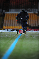 A groundsman paints the lines blue, because of the snow, before the Port Vale Vs Lincoln City League Two game<br />