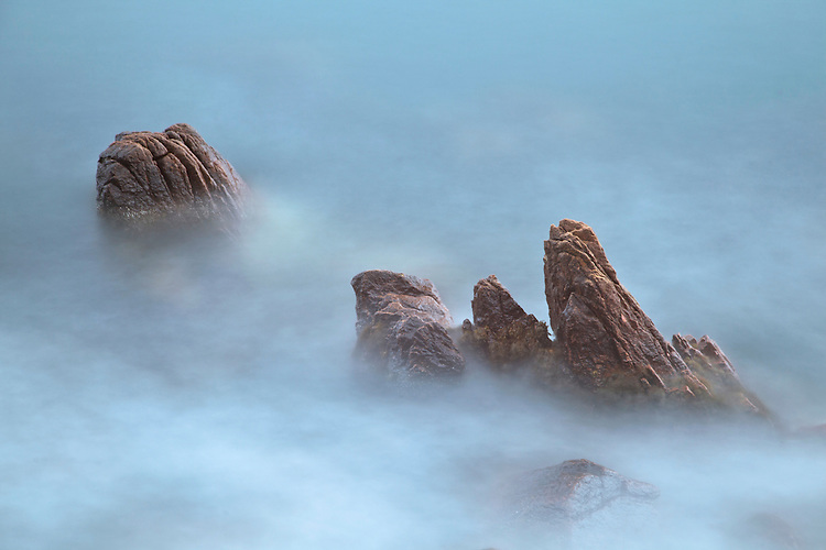 Rocks blend into the waves offshore near Bass Harbor at Acadia National Park, Maine, USA