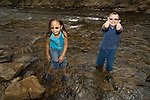 young boy and girl playing near the Big Thompson River in Estes Park, Colorado, USA, summer, model released, (MR - #97 and 96).