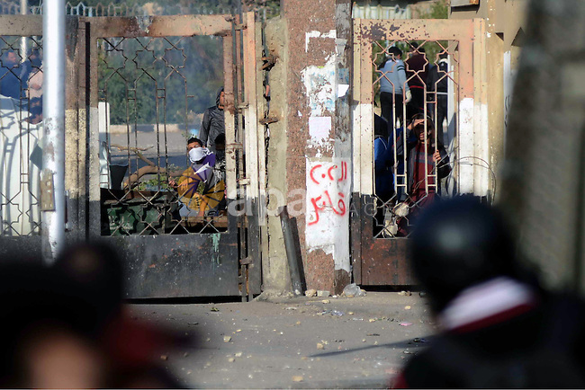 Students of Al-Azhar University, who are supporters of the Muslim Brotherhood and deposed President Mohamed Mursi, clash with riot police and residents of the area at the Al-Azhar University campus in Cairo's Nasr City district December 27, 2013. Muslim Brotherhood supporters and police clashed across Egypt on Friday, leaving at least three dead in protests after the army-backed government declared the group a terrorist organisation. Photo by Mohammed Bendari