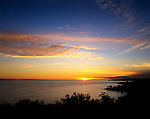 Sunset over the Pacific Ocean as viewed from Ortega Hill in Summerland, CA.