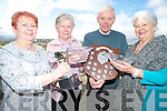 Margaret Trafford, Chairperson Killorglin Bowls Club, left and Eileen McGillycuddy, PRO, Killrglin Bowls Club, right, present Catherine O'Sullivan and James Murphy with their prizes from recent national competitions, at Killorglin Golf club on Tuesday.