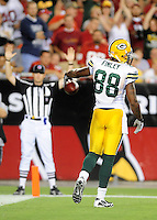 Aug. 28, 2009; Glendale, AZ, USA; Green Bay Packers tight end (88) Jermichael Finley celebrates his second quarter touchdown against the Arizona Cardinals during a preseason game at University of Phoenix Stadium. Mandatory Credit: Mark J. Rebilas-
