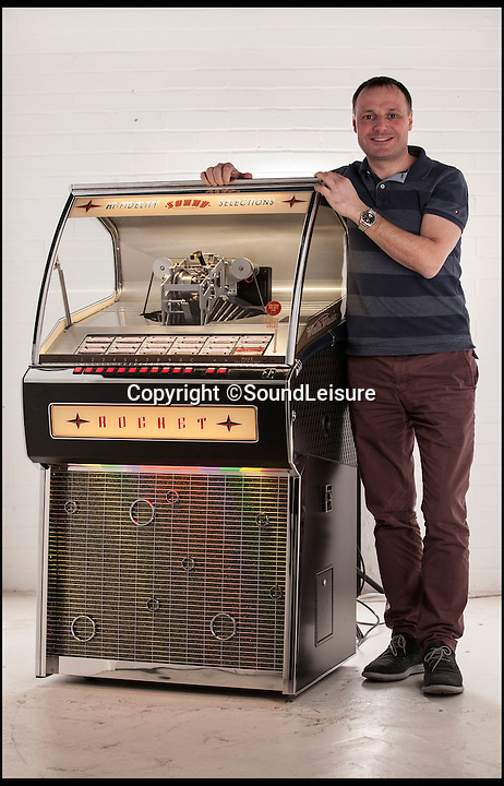 BNPS.co.uk (01202 558833)<br /> Pic: SoundLeisure/BNPS<br /> <br /> Chris Black with the machine styled on a Oldsmobile Rocket 88 motor from the 1950's..<br /> <br /> It's a one for the money...It's lift off for the retro Rocket...<br /> <br /> A British company is reviving the vinyl jukebox due to a surge in demand for the iconic record players - and there's already a six-month waiting list to get your hands on one of the £8,000 machines.<br /> <br /> Bosses at Yorkshire business Sound Leisure are launching what they say is the world's only new vinyl jukebox amid a resurgence for the much-loved music medium.<br /> <br /> The company began making vinyl jukeboxes in the late 1970s however production was cut short a decade later when the music industry moved to digital CDs.<br /> <br /> But a sharp rise in vinyl sales in recent years convinced them to have another shot at the market - and they have spent the last three years re-engineering their original design for modern music fans.