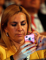 Il sottosegretario alla Pubblica Amministrazione Michaela Biancofiore all'assembea annuale della Confcommercio a Roma, 12 giugno 2013.<br /> Italian Public Function undersecretary Michaela Biancofiore uses her mobile phone during the Italian Confcommercio traders association's annual assembly in Rome, 12 June 2013.<br /> UPDATE IMAGES PRESS/Riccardo De Luca