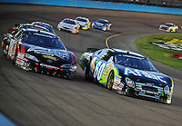 Apr 17, 2009; Avondale, AZ, USA; NASCAR Nationwide Series driver Carl Edwards (60) races alongside Kyle Busch (18) during the Bashas Supermarkets 200 at Phoenix International Raceway. Mandatory Credit: Mark J. Rebilas-
