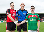 Shane Brennan of Clondegad and Martin Mc Mahon of Kilmurry Ibrickane with referee Pat Cosgrove before their senior county final at Cusack park. Photograph by John Kelly.