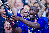 Sol Bamba sprays champagne after the Sky Bet Championship match between Cardiff City and Reading at the Cardiff City Stadium, Cardiff, Wales on 6 May 2018. Photo by Mark  Hawkins / PRiME Media Images.