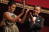 United States President Barack Obama and First Lady Michelle Obama (C) attend the Kennedy Center Honors at the Kennedy Center on December 2, 2012 in Washington, DC. The Kennedy Center Honors recognized seven individuals - Buddy Guy, Dustin Hoffman, David Letterman, Natalia Makarova, John Paul Jones, Jimmy Page, and Robert Plant - for their lifetime contributions to American culture through the performing arts. .Credit: Brendan Hoffman / Pool via CNP