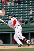 First baseman Nick Longhi (21) of the Greenville Drive bats in a game against the Lexington Legends on Tuesday, April 14, 2015, at Fluor Field at the West End in Greenville, South Carolina. Longhi is the No. 27 prospect of the Boston Red Sox, according to Baseball America. Lexington won, 5-3. (Tom Priddy/Four Seam Images)