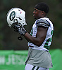Bilal Powell #29 of the New York Jets puts on his helmet after a momentary break in Training Camp at the Atlantic Health Jets Training Center in Florham Park, NJ on Tuesday, Aug. 7, 2018.