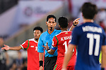 FIFA Referee Mohd Amirul Izwan of Malaysia (C) speaks to Ahmed Al Mahaijri of Oman (R) during the AFC Asian Cup UAE 2019 Group F match between Oman (OMA) and Japan (JPN) at Zayed Sports City Stadium on 13 January 2019 in Abu Dhabi, United Arab Emirates. Photo by Marcio Rodrigo Machado / Power Sport Images