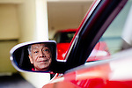 John Aguinaldo, of Los Angeles, teaches AARP Driver Safety courses. He stands with his car outside of his home in Los Angeles, California, November 27, 2013.