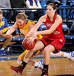 BROOKINGS, SD - FEBRUARY 21:  Mariah Clarin #40 from South Dakota State ties up Lisa Loeffler #44 from the University of South Dakota in the second half of their game Saturday evening at Frost Arena in Brookings. (Photo by Dave Eggen/Inertia)