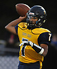 Xavier Arline #7, Shoreham-Wading River quarterback, throws a pass during a Suffolk County Division IV varsity football game against Babylon at Shoreham-Wading River High School on Friday, Oct. 20, 2017.
