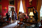 First Lady Michelle Obama and White House Curator Bill Allman, right, talk with the spouses of G8 Summit leaders in the Red Room during a tour of the White House, May 19, 2012..Mandatory Credit: Sonya N. Hebert - White House via CNP