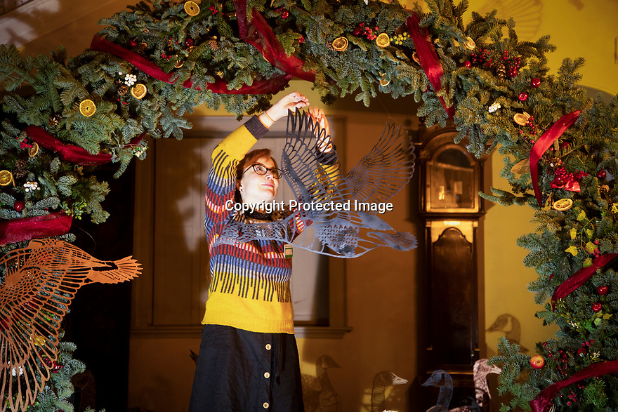 21/11/19<br /> <br /> Co-set designer, Isobel Power Smith makes the finishing touches to Sudbury Hall's decorations.<br /> <br /> Game On: A supersized snakes and ladder and other board games feature at the National Trust's Sudbury Hall, Derbyshire, where rooms have been converted into board games for Christmas. Visitors themselves are the playing pieces on the snakes and ladders board while other traditional board games featured include Scrabble, Guess Who and Cluedo.<br /> <br /> Full story:  https://rkp-press-releases.netlify.com/press-releases/2019-11-20-sudbury-hall-christmas-game-on-national-trust/<br /> <br /> <br /> All Rights Reserved: F Stop Press Ltd.  <br /> +44 (0)7765 242650 www.fstoppress.com