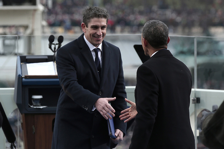 WASHINGTON, DC - JANUARY 21: U.S. President Barack Obama (R) greets poet Richard Blanco after his poem during the public ceremonial inauguration on the West Front of the U.S. Capitol January 21, 2013 in Washington, DC.   Barack Obama was re-elected for a second term as President of the United States.  (Photo by POOL Win McNamee/Getty Images)