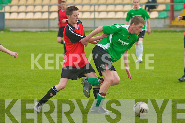 Castlesland's Ronan O'Callaghan keeps possession as Classic's Lee McCord puts the pressure on in the tightly fought game in the Division 2 league final at Mounthawk Park on Sunday afternoon.   Copyright Kerry's Eye 2008