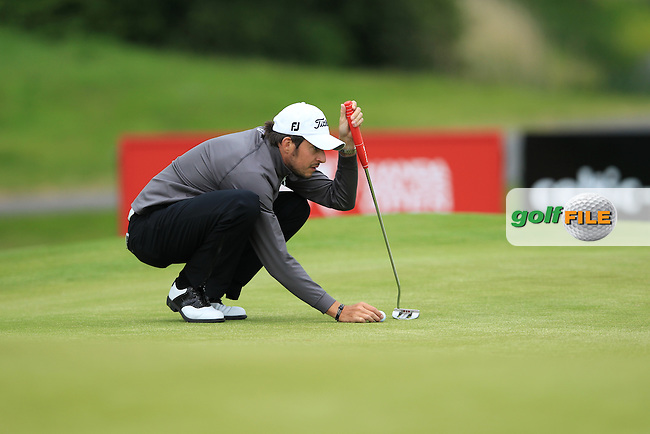 Simon Thornton (IRL) lines up his putt on the 5th green during Thursday's Round 1 of the ISPS Handa Wales Open presented by The Celtic Manor Resort, Newport, Wales, 31st May 2012 (Photo Eoin Clarke/www.golffile.ie)