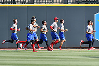 Members of the Lakewood BlueClaws run in the outfield before a game against the Columbia Fireflies on Saturday, May 6, 2017, at Spirit Communications Park in Columbia, South Carolina. Lakewood won, 1-0 with a no-hitter. (Tom Priddy/Four Seam Images)