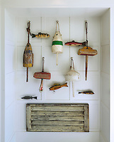 A collection of salvaged buoys is displayed in an alcove of the panelled entrance hall