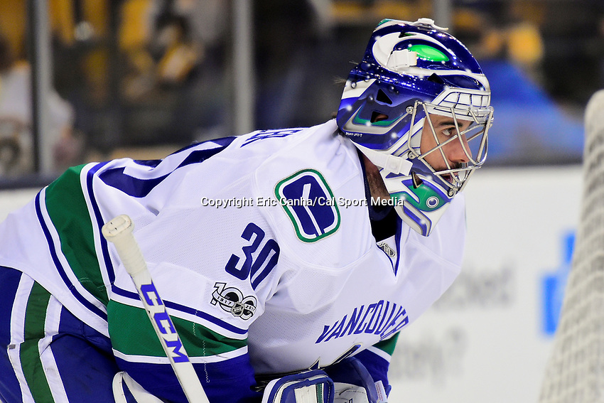 February 11, 2017: Vancouver Canucks goalie Ryan Miller (30) warms up before the National Hockey League game between the Vancouver Canucks and the Boston Bruins held at TD Garden, in Boston, Mass. Boston defeats Vancouver 4-3 in regulation time. Eric Canha/CSM