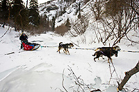 Scottish musher Wattie McDonald manuevers his sled over glare ice of Dalzell Creek in the Dalzell Gorge between Rainy Pass summit and Rohn during the 2010 Iditarod, Southcentral Alaska
