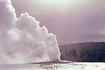 Wyoming: Yellowstone National Park.  Old Faithful Geyser in winter.  Photo #: wyyelw101..Photo copyright Lee Foster, www.fostertravel.com, 510/549-2202, lee@fostertravel.com
