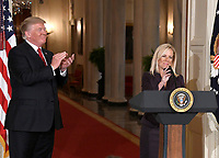 United States President Donald J. Trump, left, applauds after announcing he will name Principal Deputy White House Chief of Staff Kirstjen Nielsen, right, as Secretary of Homeland Security in the East Room of the White House in Washington, DC on Thursday, October 12, 2017.  If confirmed, Nielsen will replace Acting US Secretary of Homeland Security Elaine C. Duke, who has been in that position since General John F. Kelly, USMC (Retired) resigned to become White House Chief of Staff.<br /> Credit: Ron Sachs / CNP /MediaPunch