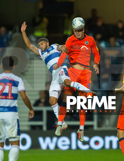 QPR Nahki Wells and Millwall's Jake Cooper during the Sky Bet Championship match between Queens Park Rangers and Millwall at Loftus Road Stadium, London, England on 19 September 2018. Photo by Andrew Aleksiejczuk / PRiME Media Images.