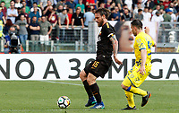 Roma s Daniele De Rossi, left, is challenged by Chievo Verona s Perparim Hetemaj during the Italian Serie A football match between Roma and Chievo Verona at Rome's Olympic stadium, 28 April 2018.<br /> UPDATE IMAGES PRESS/Riccardo De Luca