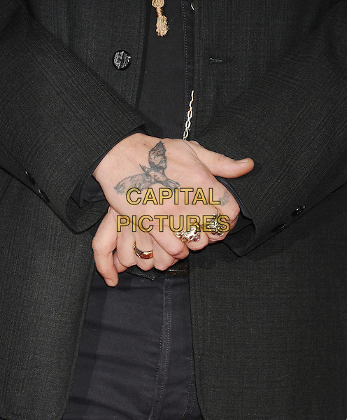 HOLLYWOOD, CA - JANUARY 21: Actress Johnny Depp (rings, tattoo detail) at The Los Angeles Premiere Of 'Mortdecai' at TCL Chinese Theatre on January 21, 2015 in Hollywood, California.<br /> CAP/ROT/TM<br /> &copy;TM/Roth Stock/Capital Pictures