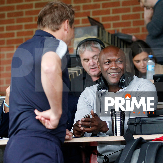 Ex-Don Marcus Gayle shares a joke with AFC Wimbledon manager, Neal Ardley during the Carabao Cup match between AFC Wimbledon and Brentford at the Cherry Red Records Stadium, Kingston, England on 8 August 2017. Photo by Carlton Myrie.