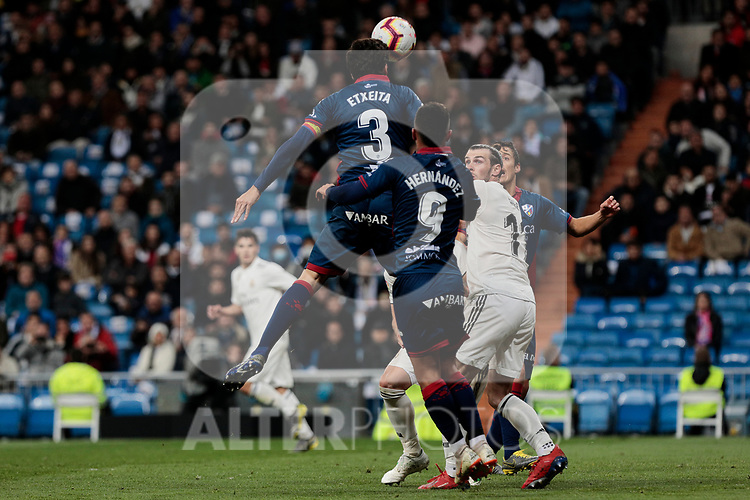 Real Madrid's Gareth Bale and SD Huesca's Xabier Etxeita (L) and Juan Camilo 'Cucho' Hernandez (R) during La Liga match between Real Madrid and SD Huesca at Santiago Bernabeu Stadium in Madrid, Spain.March 31, 2019. (ALTERPHOTOS/A. Perez Meca)