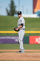 Glendale Desert Dogs relief pitcher Danny Dopico (26), of the Chicago White Sox organization, gets ready to deliver a pitch during an Arizona Fall League game against the Mesa Solar Sox at Sloan Park on October 27, 2018 in Mesa, Arizona. Glendale defeated Mesa 7-6. (Zachary Lucy/Four Seam Images)
