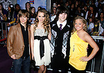 "HOLLYWOOD, CA. - February 24: Actors Jason Earles, Emily Osment, Mitchel Musso and Gymnast Shawn Johnson  arrive at the Los Angeles premiere of ""Jonas Brothers: The 3D Concert Experience"" at the El Capitan Theatre on February 24, 2009 in Los Angeles, California."