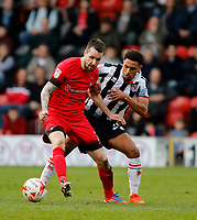 Leyton Orient's Michael Collins is shadowed by Grimsby Town's Brandon Comley during the Sky Bet League 2 match between Leyton Orient and Grimsby Town at the Matchroom Stadium, London, England on 11 March 2017. Photo by Carlton Myrie / PRiME Media Images.
