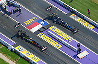 Apr. 28, 2012; Baytown, TX, USA: NHRA top fuel dragster driver Doug Kalitta (left) races alongside teammate David Grubnic during qualifying for the Spring Nationals at Royal Purple Raceway. Mandatory Credit: Mark J. Rebilas-