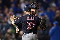 Cleveland Indians pitcher Cody Allen (37) hugs catcher Yan Gomes (10) after closing out Game 3 of the Major League Baseball World Series against the Chicago Cubs on October 28, 2016 at Wrigley Field in Chicago, Illinois.  (Mike Janes/Four Seam Images)