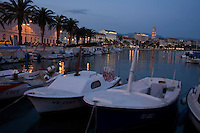 The seaside town of Split in Croatia supports a large,boat filled harbor.