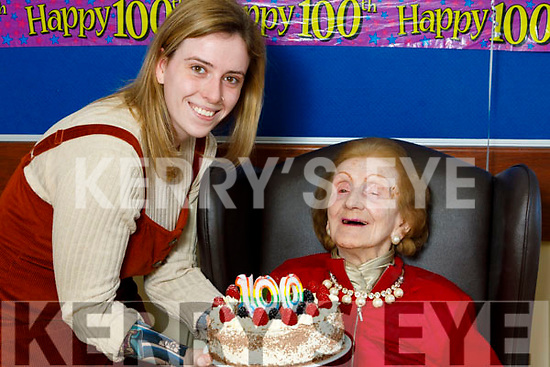 Joan Hayes celebrating her 100th birthday in the Oaklands Nursing Home in Listowel on Thursday as her grand daughter Ava Codrich helps her with the cake.