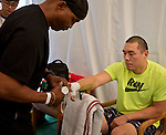Heavyweight Zhang Zhilei from Henan Province, China, gets taped before his fight with Curtis Lee Tate from Memphis Tenn. during the Rural Rumble on Friday night, August 8, 2014 at Churchill County Fairgrounds in Fallon, Nevada.