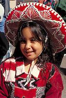 Girl age 6 wearing ethnic clothing at Cinco de Mayo Festival.  St Paul  Minnesota USA