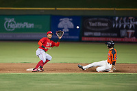 AZL Angels second baseman Gleyvin Pineda (72) prepares to apply a tag to Nick Hill (22) during a game against the AZL Giants on July 10, 2017 at Scottsdale Stadium in Scottsdale, Arizona. AZL Giants defeated the AZL Angels 3-2. (Zachary Lucy/Four Seam Images)