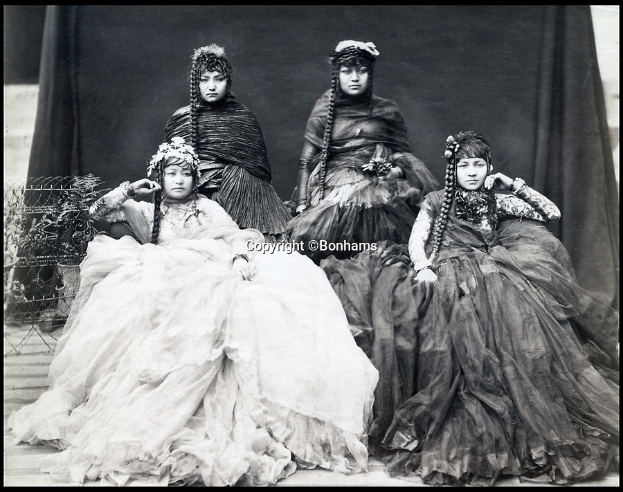 BNPS.co.uk (01202)558833Pic:  Bonhams/BNPS<br /> <br /> Nepalese ladies of the court.<br /> <br /> Amazing portraits of Maharajas looking their most resplendent have come to light 150 years later.<br /> <br /> The snaps reveal the remarkably elaborate outfits worn by members of the Indian ruling class in the mid 19th century.<br /> <br /> One striking photo shows a Maharaja on horseback holding a long spear, while another is of an Indian ruler in his finery on his throne.<br /> <br /> There are also photos of Nepalese ladies of the court in spectacular dresses and high ranking British officials.