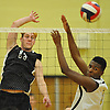 Owen Bradley #17 of Bellmore JFK, left, tries to get a spike past Zion Spruill #31 of West Hempstead during a Nassau County Conference B-1 varsity boys volleyball match at West Hempstead High School on Thursday, Oct. 13, 2016. Bellmore JFK won 3-1.