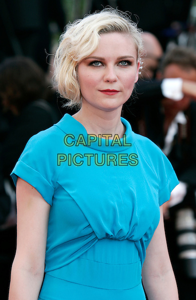 KIRSTEN DUNST.Attending the Palme d'Or Closing Ceremony held at the Palais des Festivals during the 63rd Annual International Cannes Film Festival,.Cannes, France, May 23rd, 2010.half length blue turquoise dress round neck cap sleeve red lipstick make-up .CAP/PE.©Peter Eden/Capital Pictures.
