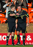 Dundee Utd v St Johnstone...25.09.10  .Ref Brian Winter talks with asst ref.Picture by Graeme Hart..Copyright Perthshire Picture Agency.Tel: 01738 623350  Mobile: 07990 594431